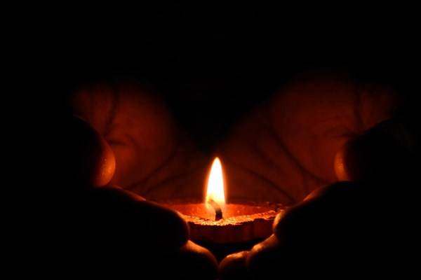 Canva Tealight Candle On Human Palms (1)